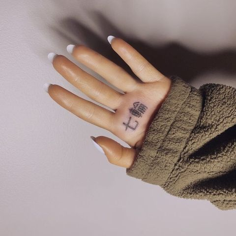Finger, Hand, Wrist, Nail, Skin, Arm, Gesture, Ring, Beige, Material property,