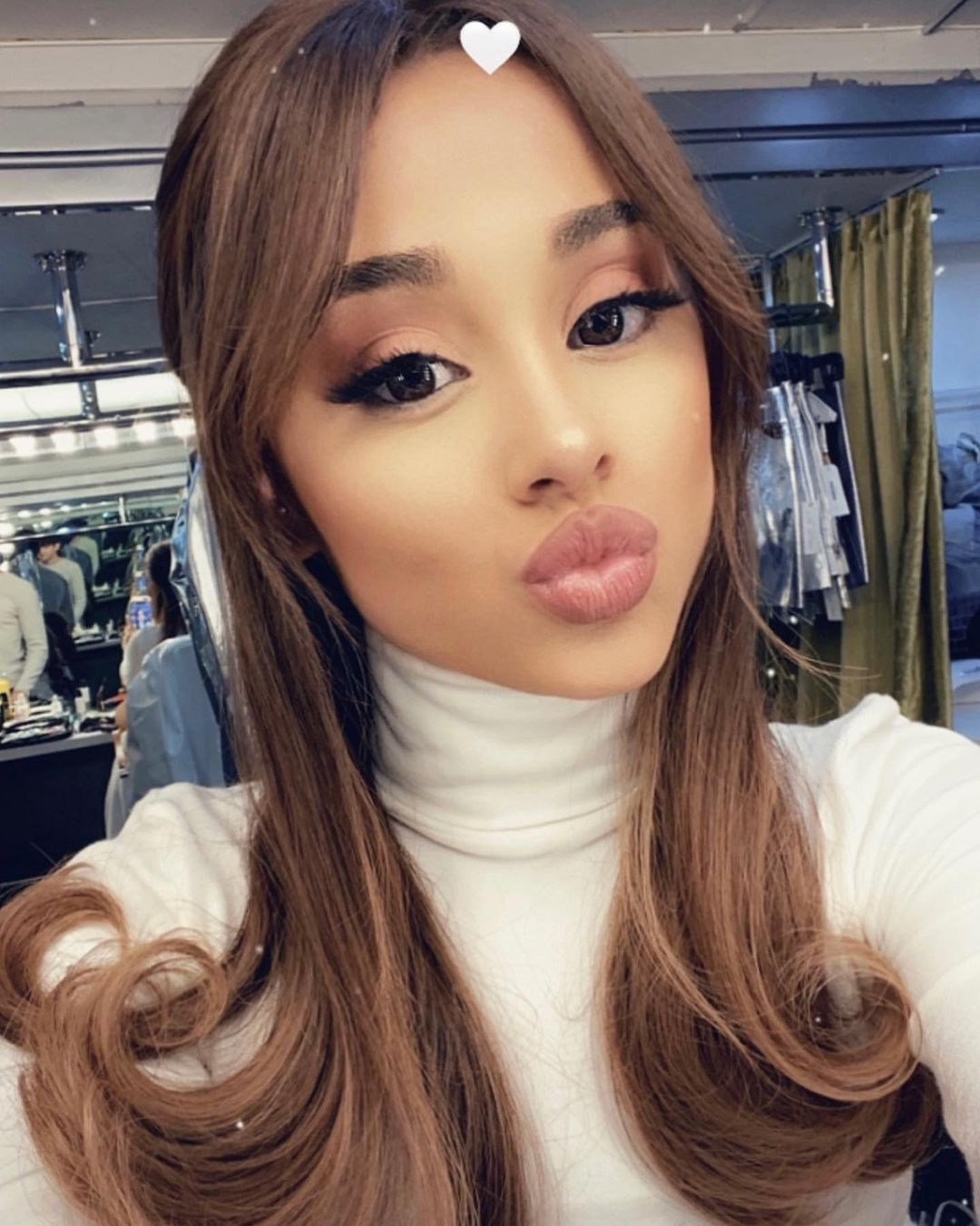 Ariana Grande Unveils 70s Inspired Curtain Bangs On Instagram