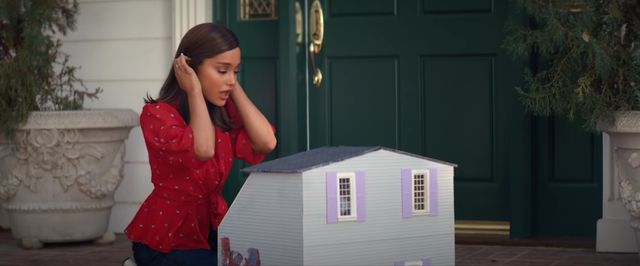 girl with gray dollhouse