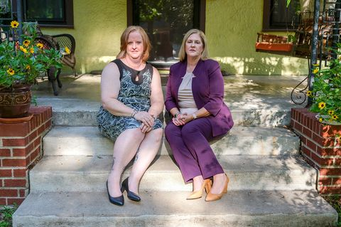 sisters christie and julie burkhart pose for a portait at julie burkhart's home in wichita, kansas on august 28, 2021