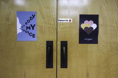 signs adorn the doors that lead to examination and operating rooms at trust women in wichita, kansas