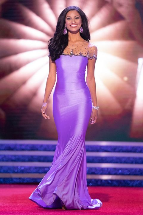Dress, Fashion model, Clothing, Gown, Red carpet, Carpet, Purple, Fashion, Shoulder, Flooring,