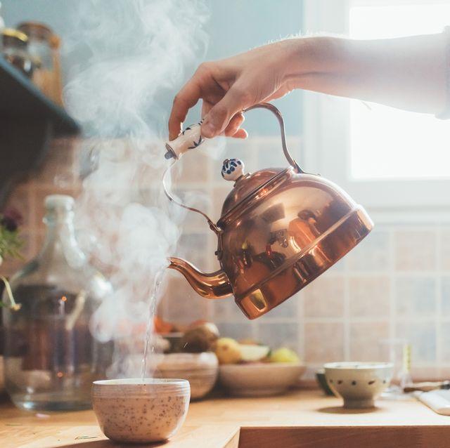 Small appliance, Room, Teapot, Design, Hand, Glass, Table, Interior design, Kitchen, Copper,
