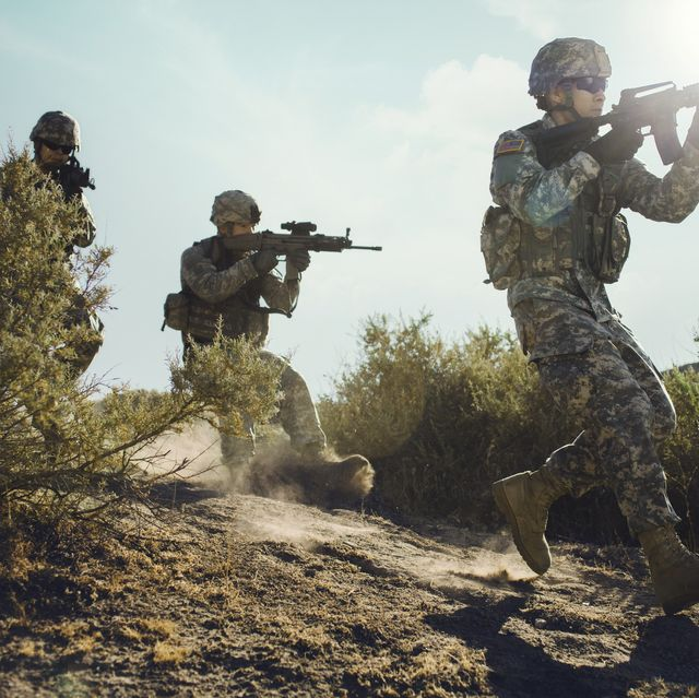 army soldiers advancing in combat