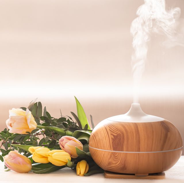 aroma oil diffuser lamp on the table