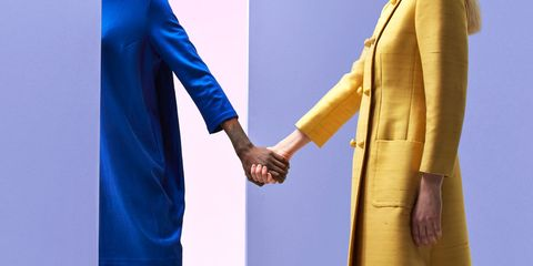 Blue, Yellow, Suit, Gesture, Electric blue, Formal wear, Standing, Interaction, Outerwear, Hand,