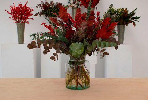 Centro de flores floliage para Navidad