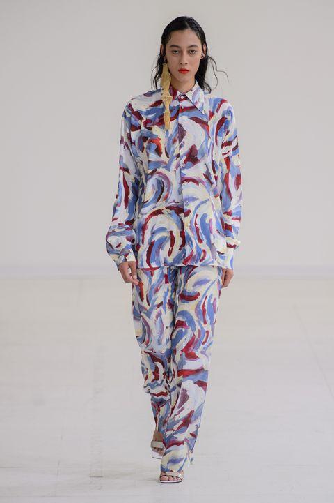 Clothing, Fashion model, Fashion, Fashion show, Runway, Pajamas, Neck, Sleeve, Fashion design, Electric blue,