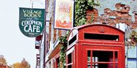 Telephone booth, Public space, Property, Neighbourhood, Infrastructure, Photograph, City, Red, Wall, Urban area,