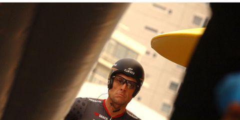Jersey, Sports uniform, Sports gear, Sportswear, Cap, Helmet, Personal protective equipment, Logo, Sports jersey, Bicycle jersey,