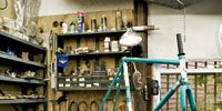 Bicycle accessory, Bicycle frame, Shelf, Shelving, Workshop, Bicycle, Bicycle fork, Collection, Bicycle part, Bottle,