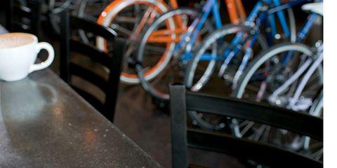 Coffee cup, Wood, Bicycle wheel rim, Serveware, Bicycle tire, Bicycle wheel, Cup, Dishware, Drinkware, Bicycle frame,