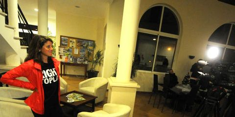 Lighting, Room, Video camera, Interior design, Tripod, Camera accessory, Camera, Interior design, Bag, Couch,