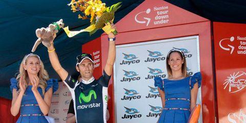 Dress, Electric blue, Logo, Cobalt blue, Award ceremony, Award, Cycling shorts, Cheerleading uniform, Cheering, Spandex,