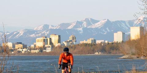 Mountainous landforms, Bicycle frame, Bicycle wheel, Bicycles--Equipment and supplies, Mountain range, Bicycle, Bicycle helmet, Bicycle handlebar, Helmet, Cycling,