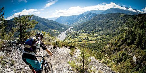 Bicycle wheel, Tire, Wheel, Bicycle frame, Mountain bike, Mountain biking, Sports equipment, Bicycle tire, Mountainous landforms, Downhill mountain biking,