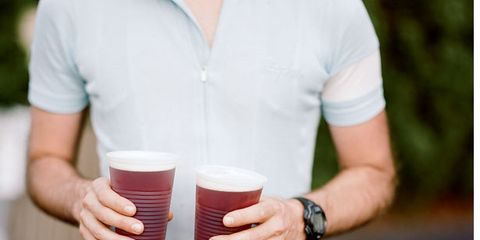 Beer, Sleeve, Drink, Alcoholic beverage, Carmine, Alcohol, Ale, Watch, Barware, Beer glass,