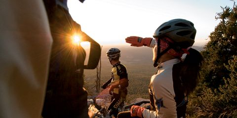 Helmet, Adventure, Bicycle helmet, Boot, Sun, Lens flare, Backpack, Shrubland, Heat, Bicycles--Equipment and supplies,