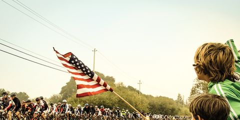 Human, People, Bicycle tire, Flag, Pole, Bicycles--Equipment and supplies, Holiday, Bicycle handlebar, Crowd, Flag of the united states,