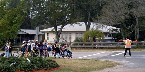 Road, Asphalt, Bicycle frame, Bicycle tire, Community, Public space, Lane, Bicycle, Thoroughfare, Pedestrian,