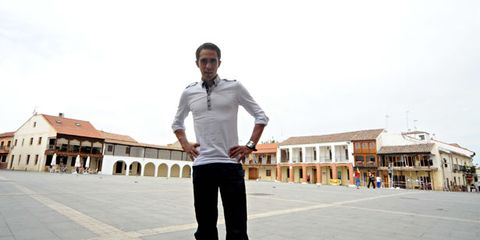 Dress shirt, Collar, Sleeve, Shirt, Standing, Town, Roof, Street fashion, Town square, Pocket,