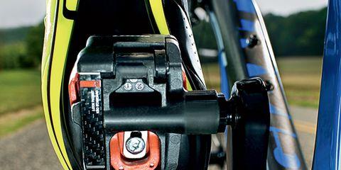 Bicycle accessory, Bicycle wheel rim, Machine, Circle, Fishing reel, Carbon, Bicycle drivetrain part, Steel, Bicycle pedal,