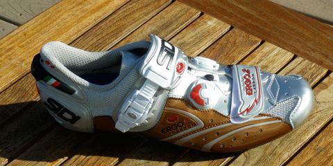 Wood, Hardwood, Sportswear, Athletic shoe, White, Floor, Flooring, Logo, Wood stain, Carmine,