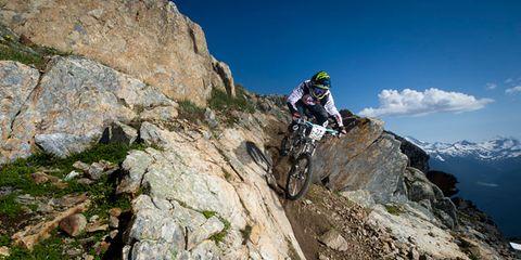 Helmet, Sports equipment, Bicycle clothing, Bicycle helmet, Mountain, Adventure, Outdoor recreation, Rock, Personal protective equipment, Bedrock,