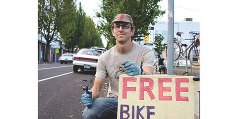 Cap, Denim, Asphalt, Auto part, Baseball cap, Street fashion, Signage, Sidewalk, Bicycle wheel, Vehicle registration plate,