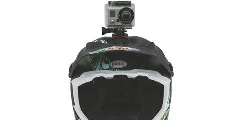Green, Personal protective equipment, Cameras & optics, Camera accessory, Plastic, Digital camera, Film camera, Lens, Motorcycle accessories, Camera,