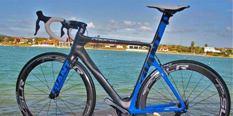 Bicycle frame, Tire, Bicycle tire, Wheel, Bicycle wheel rim, Mode of transport, Blue, Bicycle wheel, Bicycle part, Bicycle fork,