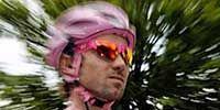 Pink, Headgear, Costume accessory, Fictional character, Costume, Goggles, Symbol, Wing, Feather, Costume design,