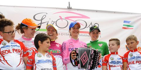 Cycling shorts, Uniform, Podium, Championship, Competition, Baseball cap, Medal, Award, Crew, Flag,