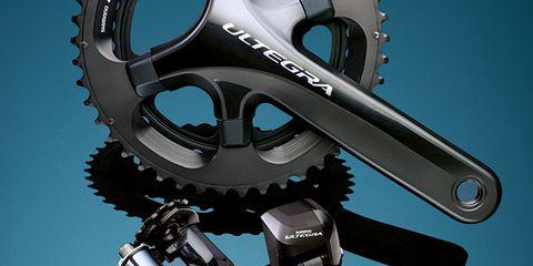 Bicycle part, Bicycle drivetrain part, Crankset, Gear, Motorcycle accessories, Groupset, Machine, Circle, Steel, Aluminium,