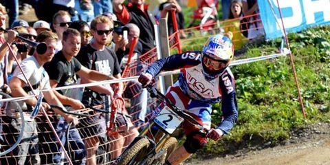 Soil, Sports gear, Helmet, Off-roading, Trail, Racing, Championship, Sunglasses, Enduro, Motorcycle racer,
