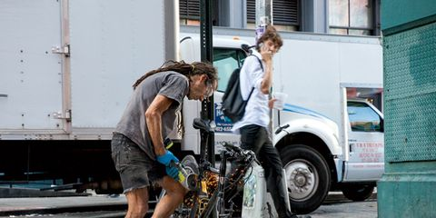 Automotive tire, Fender, Shorts, Bicycle wheel, Street, Street fashion, Auto part, Automotive wheel system, Sidewalk, Bicycle tire,