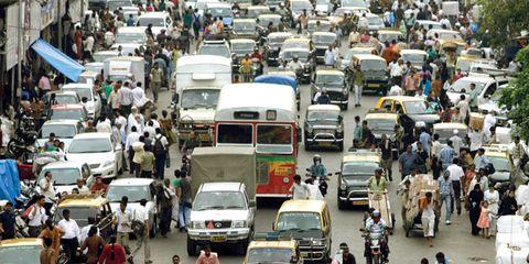 Motor vehicle, Mode of transport, People, Vehicle, Transport, Land vehicle, Bus, Automotive parking light, Traffic, Passenger,
