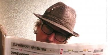 Eyewear, Vision care, Glasses, Hat, Publication, News, Muscle, Facial hair, Paper product, Sun hat,