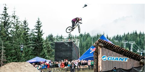 People, Crowd, Soil, Leisure, Stunt performer, Audience, Extreme sport, Stunt, Cycle sport, Jumping,