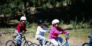 Wheel, Tire, Bicycle wheel, Bicycle handlebar, Helmet, Bicycle, Bicycle frame, Land vehicle, Bicycle part, Bicycle helmet,