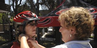 Nose, Bicycle helmet, Helmet, Bicycles--Equipment and supplies, Red, Bicycle clothing, Mammal, Community, Personal protective equipment, Sports gear,