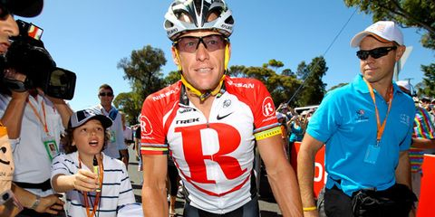 Clothing, Eyewear, Vision care, Bicycle jersey, Sports uniform, Bicycles--Equipment and supplies, Bicycle helmet, Sportswear, Helmet, Sports equipment,