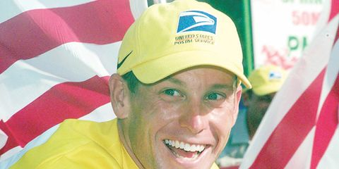 Yellow, Cap, Happy, Jersey, Facial expression, Logo, Baseball cap, Headgear, Tooth, Cricket cap,