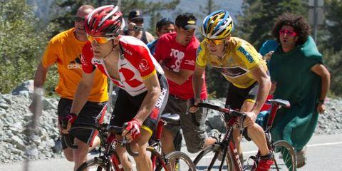 Footwear, Tire, Wheel, Bicycle wheel, Bicycle jersey, Bicycles--Equipment and supplies, Helmet, Bicycle frame, Bicycle wheel rim, Bicycle helmet,