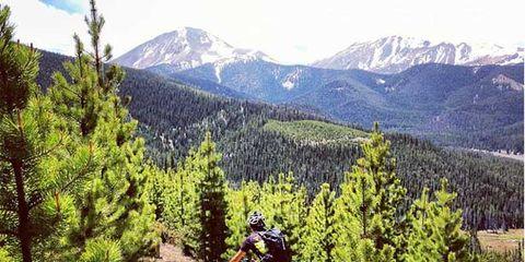 Wheel, Mountainous landforms, Mountain bike, Bicycle wheel, Mountain range, Sports equipment, Mountain biking, Bicycle frame, Downhill mountain biking, Cross-country cycling,