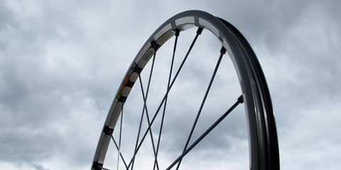 Bicycle wheel rim, Daytime, Sky, Bicycle tire, Cloud, Spoke, Rim, Sunlight, Colorfulness, Iron,