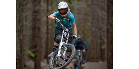 Motorcycle, Tire, Wheel, Soil, Motorcycle helmet, Motorcycling, Extreme sport, Personal protective equipment, Helmet, Adventure,