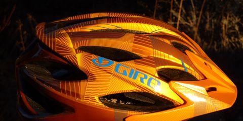 Orange, Personal protective equipment, Amber, Helmet, Headgear, Bicycle helmet, Sports gear, Bicycles--Equipment and supplies, Motorcycle helmet, Motorcycle accessories,