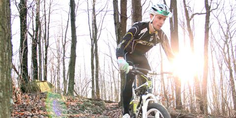 Mountain biker using momentum to his advantage.