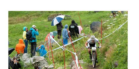 Soil, Outdoor recreation, Grassland, Umbrella, Bicycle frame, Adventure, Slope, Walking, Bicycle, Adventure racing,